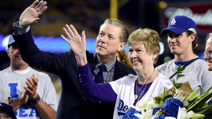 Dodgers organist Nancy Bea Hefley poses wth former star pitcher Orel Hershiser during an on-field ceremony before the team's game against the Padres on Friday night.