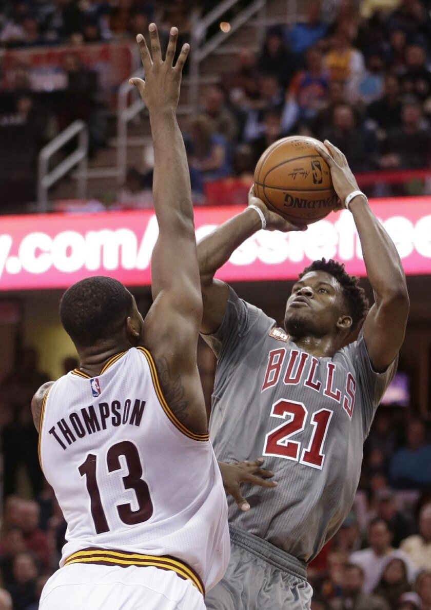 Chicago Bulls' Jimmy Butler (21) shoots over Cleveland Cavaliers' Tristan Thompson (13), from Canada, in the second half of an NBA basketball game Saturday, Jan. 23, 2016, in Cleveland. The Bulls won 96-83. (AP Photo/Tony Dejak)