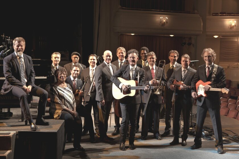 Lyle Lovett (at center, with guitar) poses with an earlier edition of his aptly named Large Band.