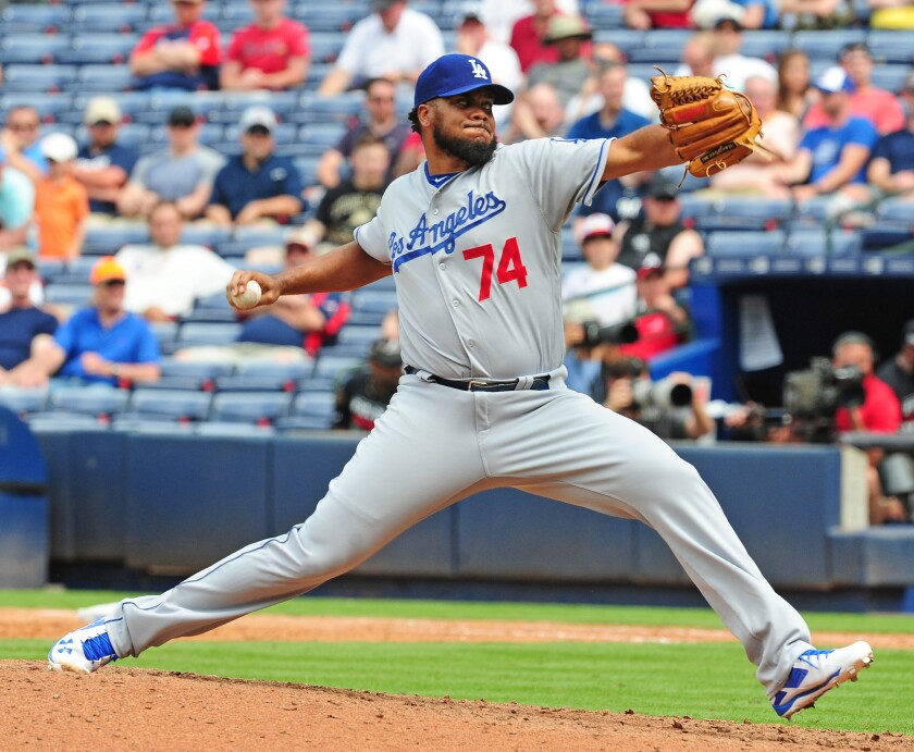 Kenley Jansen of the Los Angeles Dodgers pitches during a game in Atlanta. Rep. Janice Hahn is prodding Time Warner Cable and AT&T, which owns DirecTV, to try to hammer out a distribution deal for SportsNet LA, the TV channel owned by the Dodgers.