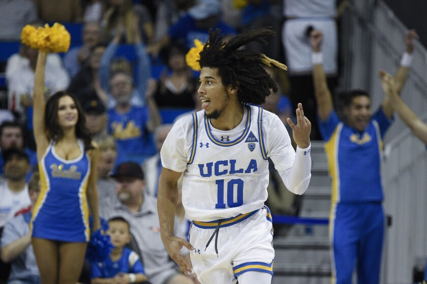 UCLA guard Tyger Campbell celebrates after making a three-point shot against Utah on Feb. 2 at Pauley Pavilion.