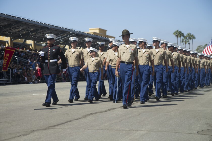 New Marines of Alpha Company, 1st Recruit Training Battalion, march in formation during a graduation ceremony at Marine Corps Recruit Depot, San Diego, Sept. 13. Public graduations will continue in the midst of the cancellation of other ceremonies by the Navy and Air Force due to coronavirus concerns.