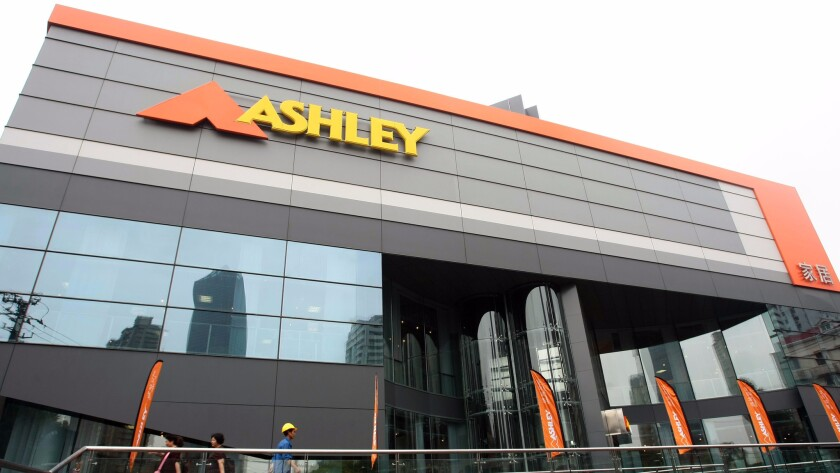 Ashley's flagship store in downtown Shanghai. The company said it is closing its plants in San Bernardino so it can compete better globally.