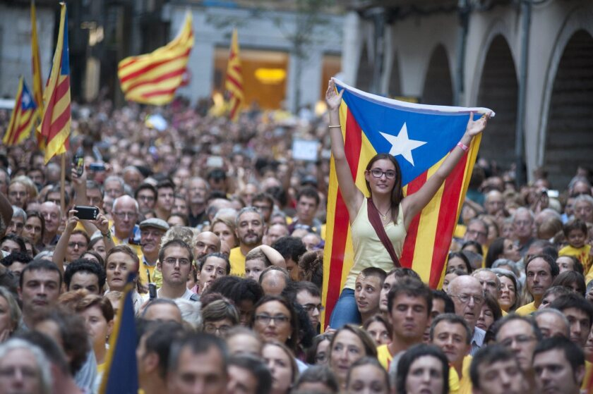 People demonstrate at town hall square against the Spanish Tribunal Constitutional prohibition of the November Catalonian independence referendum, in Gerona, Catalonia.