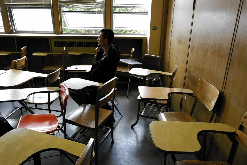 Westly Huang, a first-year student at San Francisco's City College, sits and waits for his Accelerated English class to begin.