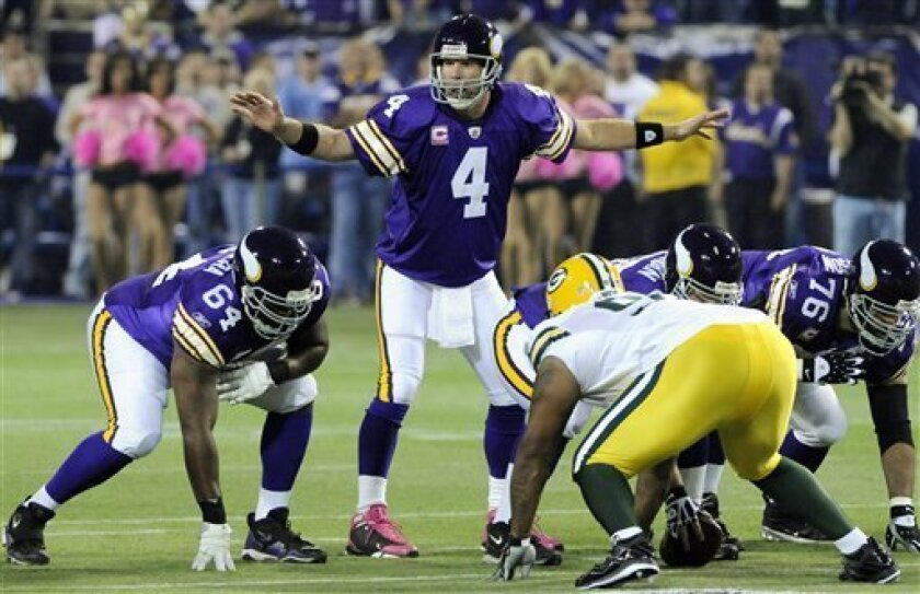 Minnesota Vikings quarterback Brett Favre (4) calls signals during the first half of an NFL football game against the Green Bay Packers on Monday, Oct. 5, 2009, in Minneapolis. (AP Photo/Jim Mone)