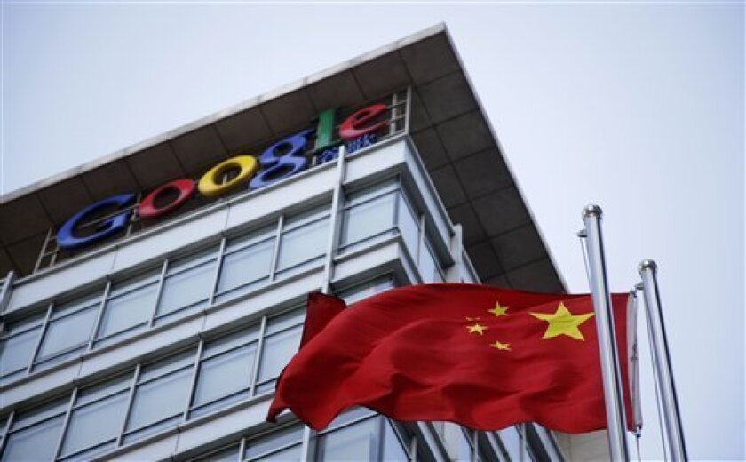 In this photo taken Friday, Jan. 22, 2010, the Chinese flag is seen near the Google sign at the Google china headquarters in Beijing, China. Google's future in China is in limbo and observers around the world are carefully tracking its dispute with Beijing. But one group is notably lukewarm on the fate of the Internet giant in the world's most populous online market: many of China's 384 million Internet users. (AP Photo/Ng Han Guan)