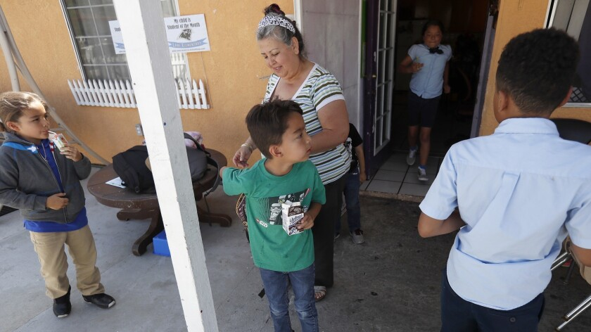 EAST LOS ANGELES, CALIF. - MAY 10, 2018. Juana Juaregui welcomes the children who congregate at he