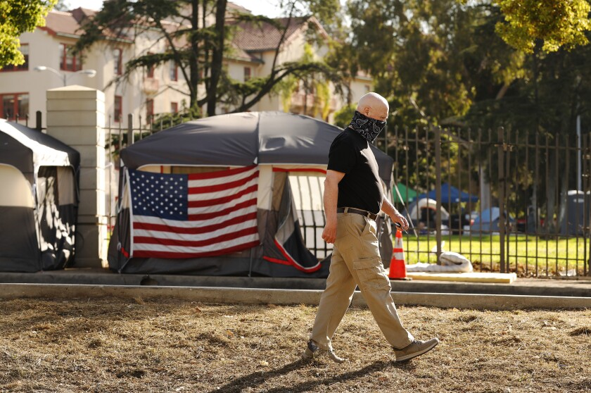 Don Wood observes a new growing homeless encampment outside the Los Angeles National Veterans Park.