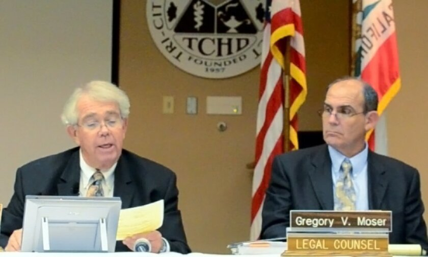 Tri-City chairman Larry Schallock reads from a prepared statement Thursday announcing that the hospital board had fired its chief executive officer Larry Anderson. At right is the hospital's attorney, Greg Moser.