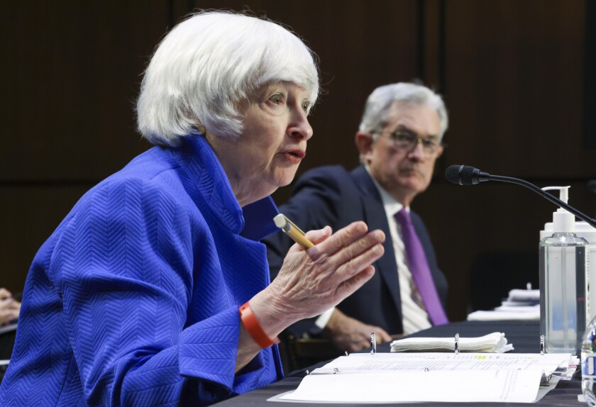 Treasury Secretary Janet Yellen, left, and Federal Reserve Chairman Jerome Powell, appear before a Senate Banking, Housing and Urban Affairs Committee hearing on the CARES Act on Capitol Hill, Tuesday, Sept. 28, 2021 in Washington. (Kevin Dietsch/Pool via AP)