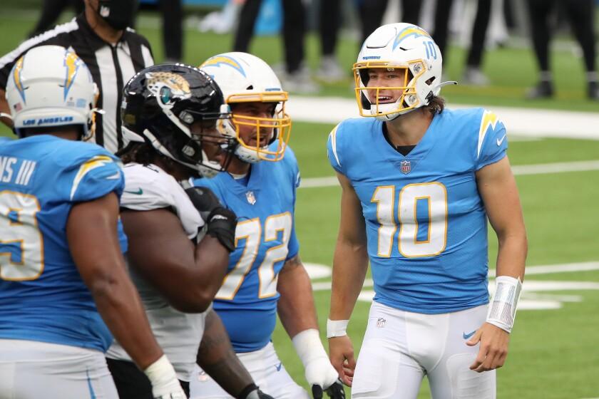 Chargers quarterback Justin Herbert celebrates a touchdown Sunday.