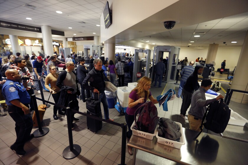 Travelers go through a security checkpoint at Los Angeles International Airport on Dec. 23, 2015.