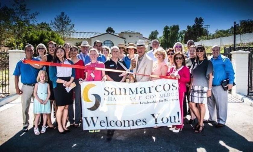 Casa de Amparo's Campus Expansion Ribbon Cutting Ceremony highlighted by Jerry Stein, Casa de Amparo board member, cutting the ribbon.