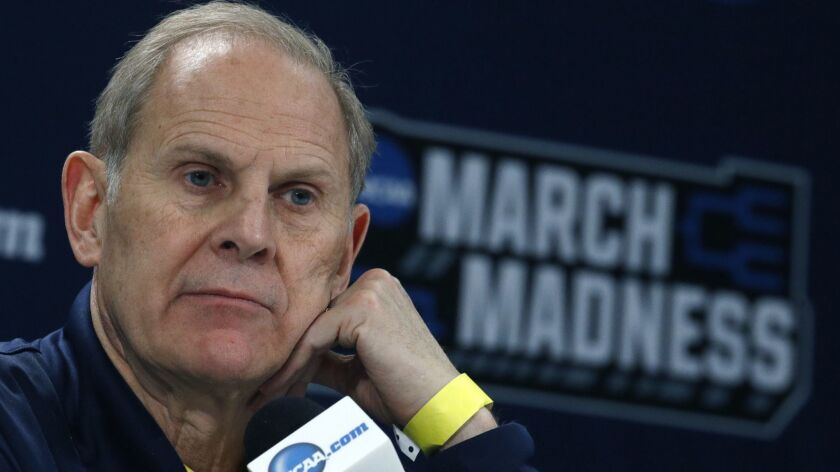 Michigan coach John Beilein talks during a news conference ahead of the NCAA basketball tournament in Wichita, Kan.