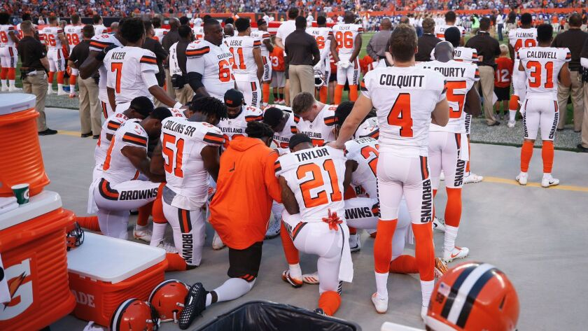 Several Cleveland players stood next to their kneeling teammates in a show of support.