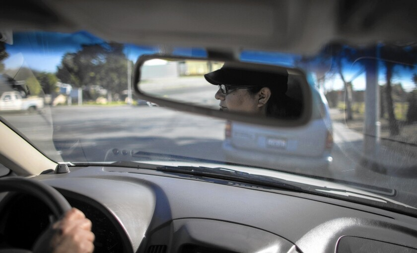 Claudia Bedolla, here running an errand in Pomona, does not have a driver's license. She is among tens of thousands in the U.S. illegally who have already made a DMV appointment to apply for one.