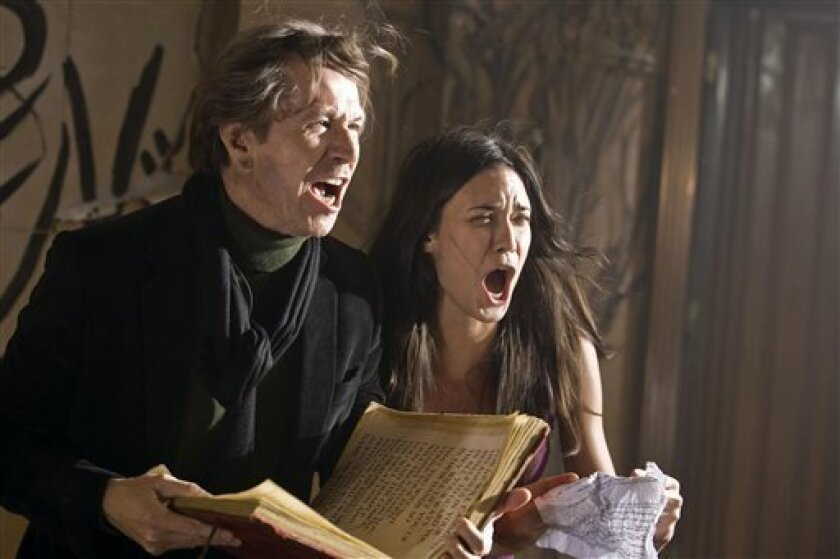 """In this image released by Rogue Pictures, Gary Oldman and Odette Yustman are shown in a scene from the supernatural thriller """"The Unborn."""" (AP Photo/Rogue Pictures, Peter Iovino)"""