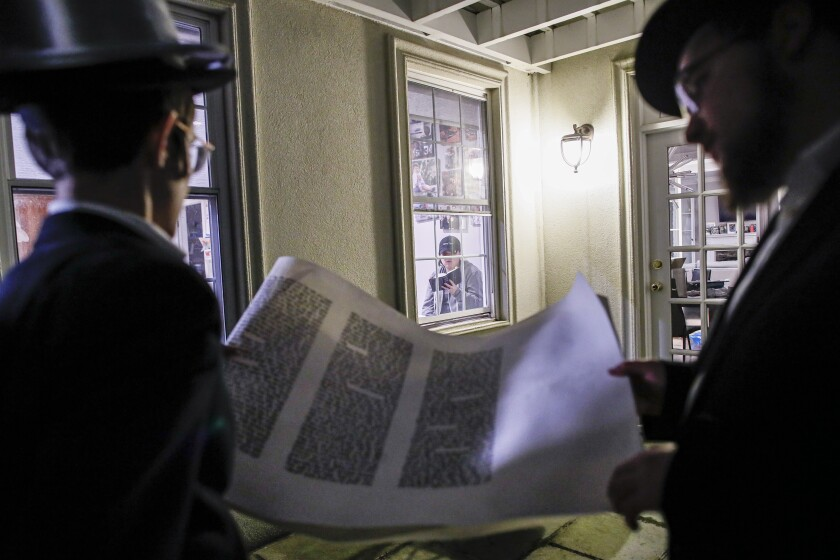 Student volunteers recite a Purim reading for residents under self-quarantine due to potential exposure to the coronavirus in New Rochelle, N.Y., on Monday.