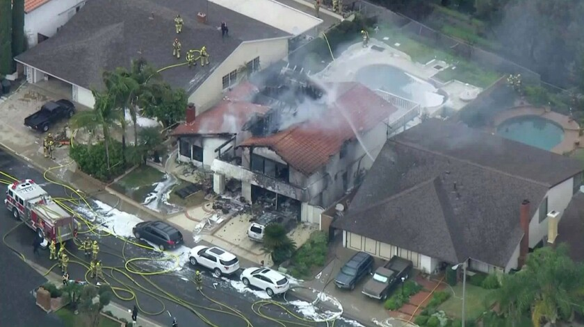 A small plane crashed into a Yorba Linda home on Sunday, killing 5 people, including the pilot.