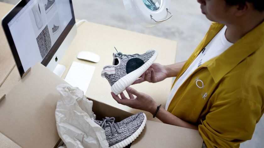 A GOAT authentication specialist verifies a pair of Kanye's Yeezy Boost 350 Turtle Dove. This sneake