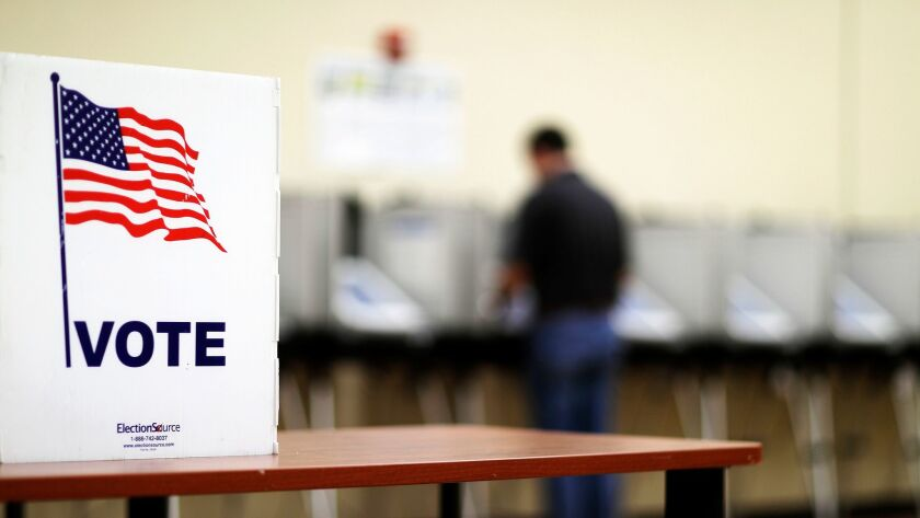 A voter casts his ballot in Georgia's 6th Congressional District special election at a polling site