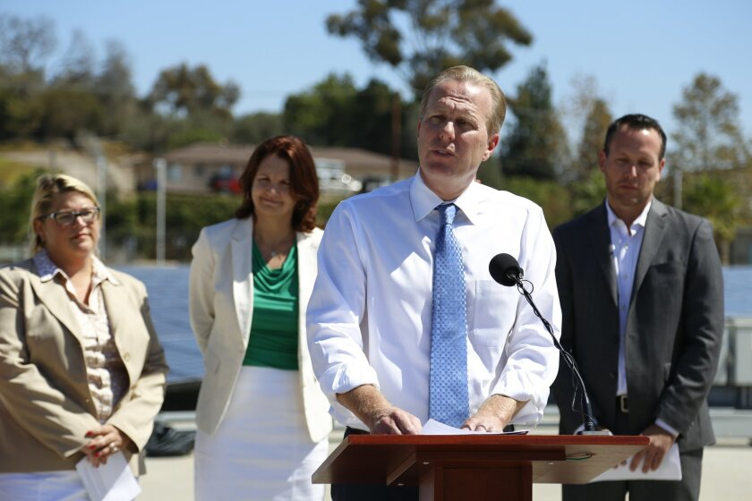 Mayor Kevin Faulconer, standing at the lectern, discusses San Diego city's draft Climate Action Plan during a conference in 2014. / photo by Alejandro Tamayo * U-T