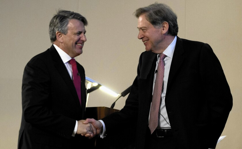 CEO Ben van Beurden, of Royal Dutch Shell, left, with BG Group Chairman Andrew Gould
