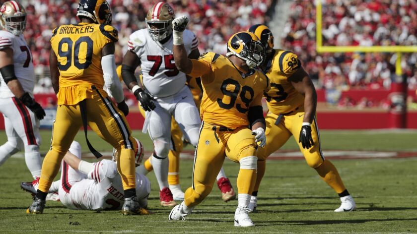 Rams defensive tackle Aaron Donald (99) reacts after sacking San Francisco 49ers quarterback C.J. Beathard (3) in the first half at Levi's Stadium on Sunday in Santa Clara.