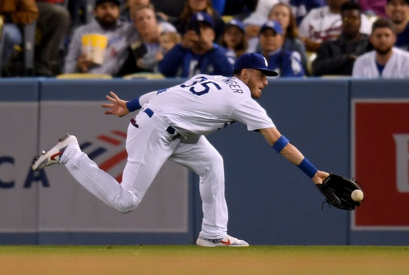 Dodgers right fielder Cody Bellinger makes a running catch.