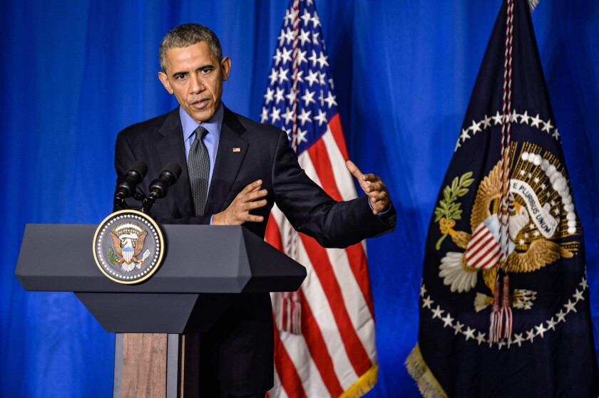 President Obama speaks during a news conference in Paris on Tuesday.