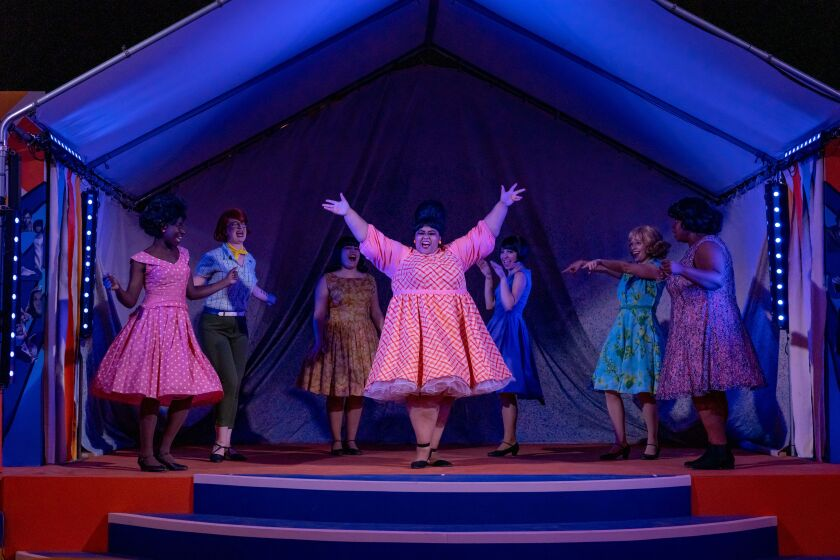 """Eboni Muse, center, with the cast of New Village Arts' """"Beehive: The '60s Musical."""""""