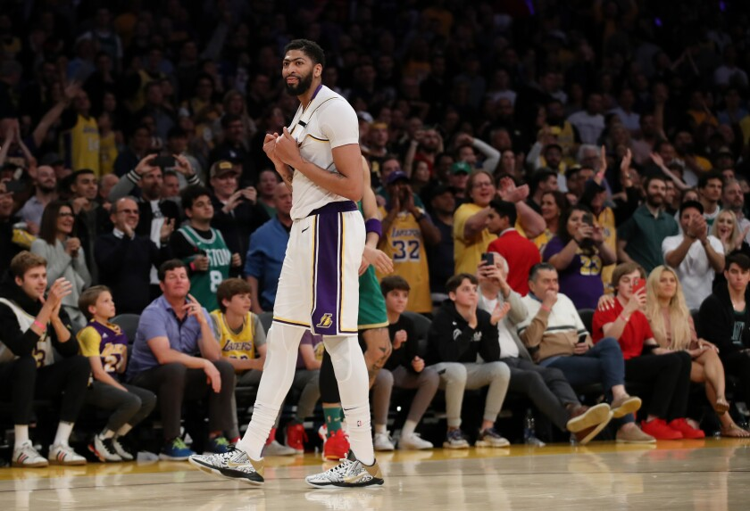 Lakers star Anthony Davis plays against the Boston Celtics on Feb. 23 at Staples Center.