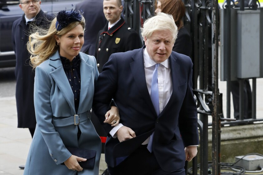 British Prime Minister Boris Johnson and his partner, Carrie Symonds