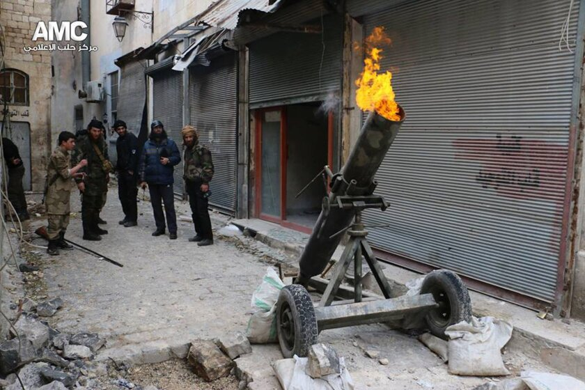 FILE - In this Sunday Feb. 15, 2015 file photo and provided on by the Syrian anti-government activist group Aleppo Media Center (AMC), which has been authenticated based on its contents and other AP reporting, shows Syrian rebels firing locally made shells against the Syrian government forces, in A