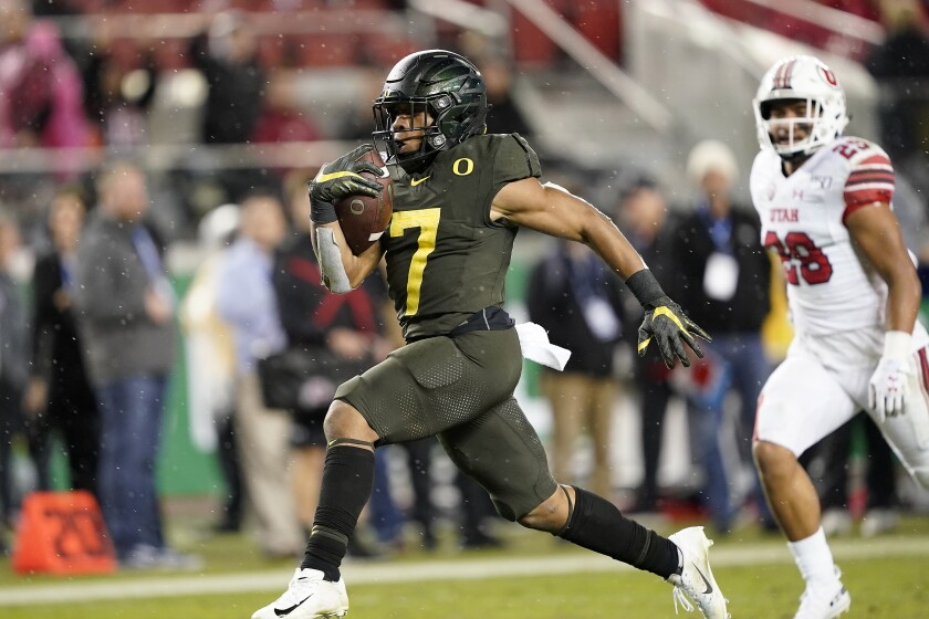 CJ Verdell, shown scoring one of three touchdowns against Utah in the Pac-12 title game, has become one of college football's top running backs in just two seasons.