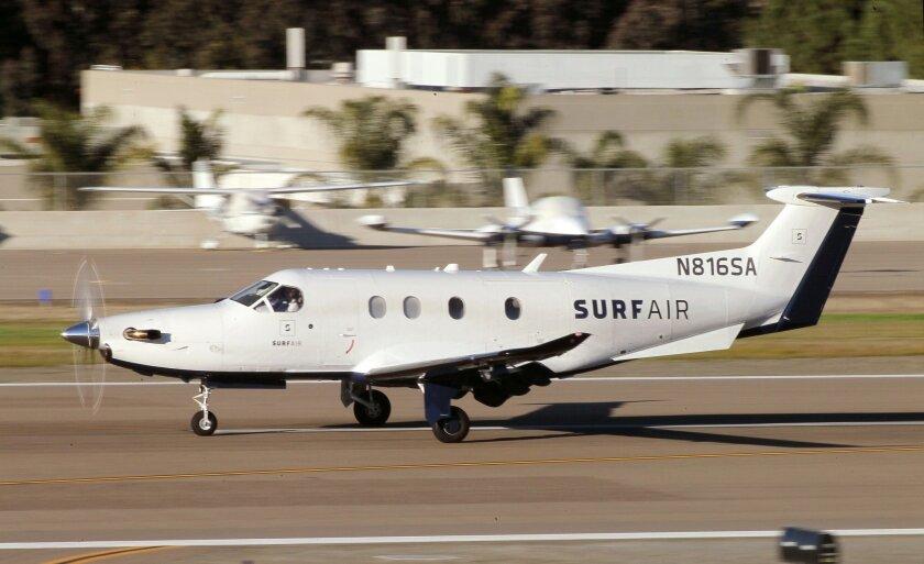 A Swiss-made Surf Air Pilatus PC-12 plane lands at McClellan-Palomar Airport in January carrying passengers from Santa Barbara.
