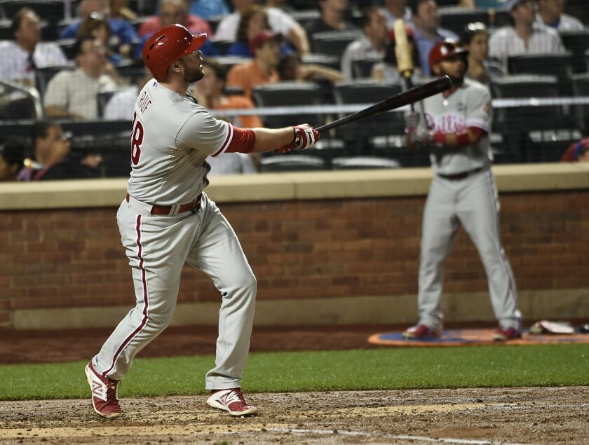 Philadelphia Phillies' Darin Ruf watches his three-run home run off of New York Mets starting pitcher Jonathon Niese during the third inning of a baseball game Tuesday, Sept. 1, 2015, in New York. (AP Photo/Kathy Kmonicek)