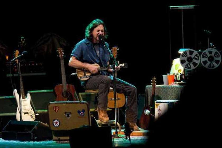 Former Pearl Jam front man Eddie Vedder performs on ukulele at the Wiltern Theater in 2011.