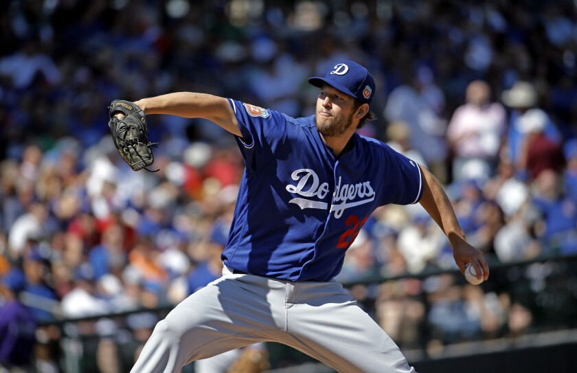 Clayton Kershaw throws during the first inning of a spring training game against the Chicago Cubs on March 8.
