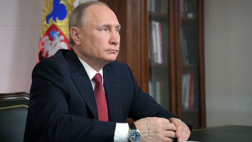 epa05878892 Russian President Vladimir Putin holds a live video link with the Russia's Arctic Sabett