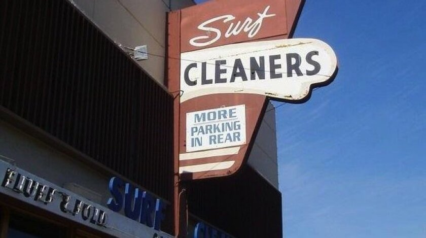 The Surf Cleaners sign before it came down. The sign has led to an interest in revising city rules to encourage old signs.