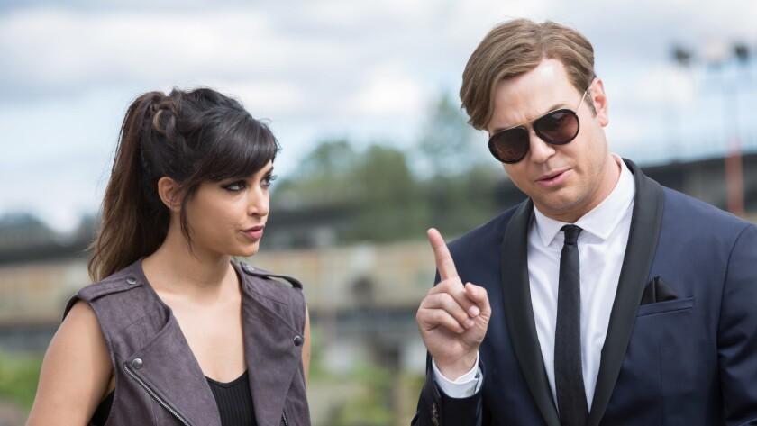 """Hannah Simone and Taran Killam in the movie """"Killing Gunther."""""""