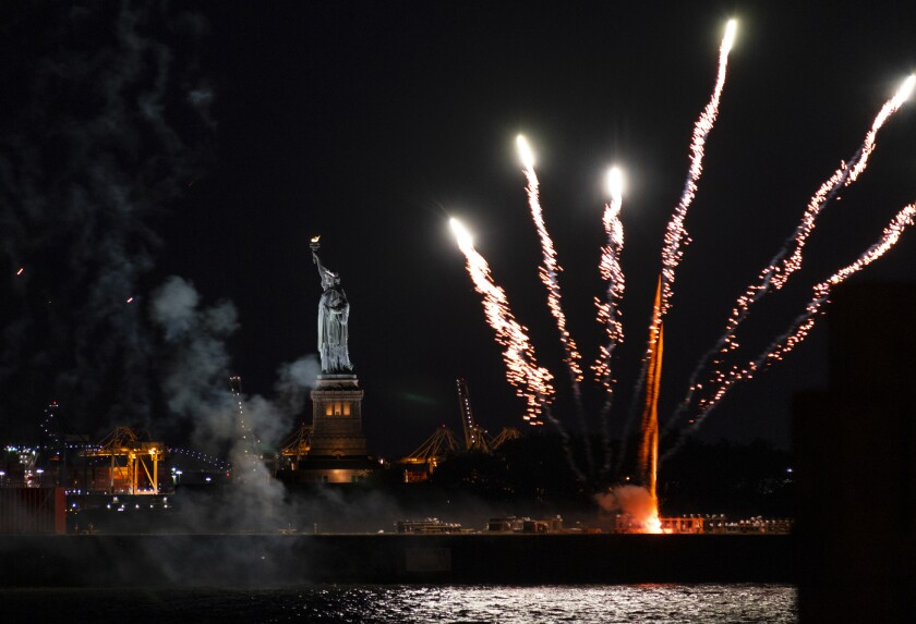 Fireworks launched from a barge explode over New York Harbor and the Statue of Liberty as New York and other cities around New York state recognize a rate of 70% for single dose vaccinations against the COVID-19 virus, Tuesday, June 15, 2021 in New York. Celebration of the milestone was announced by Gov. Andrew Cuomo earlier in the day. (AP Photo/Craig Ruttle)
