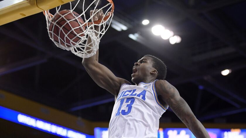 UCLA guard Kris Wilkes dunks against Loyola Marymount earlier this season.