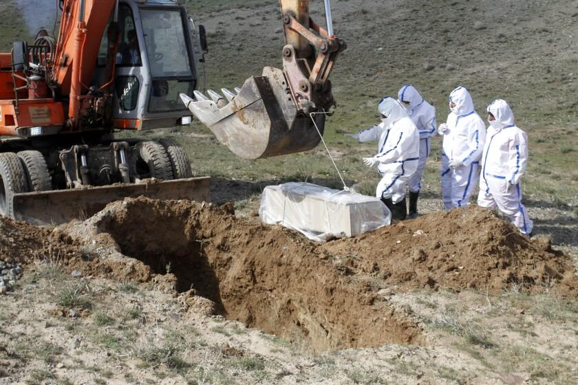 Virus Outbreak Mideast Disrupted Burials