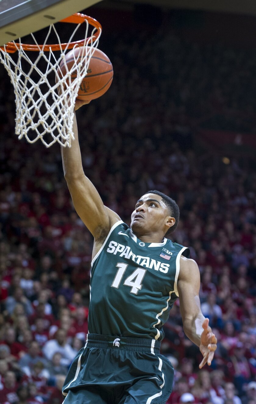 Michigan State's Gary Harris (14) takes the ball to the basket in the first half of an NCAA college basketball game against Indiana, Saturday, Jan. 4, 2014, in Bloomington, Ind. Michigan State won 73-56. Harris scored 26 points in the game. (AP Photo/Doug McSchooler)
