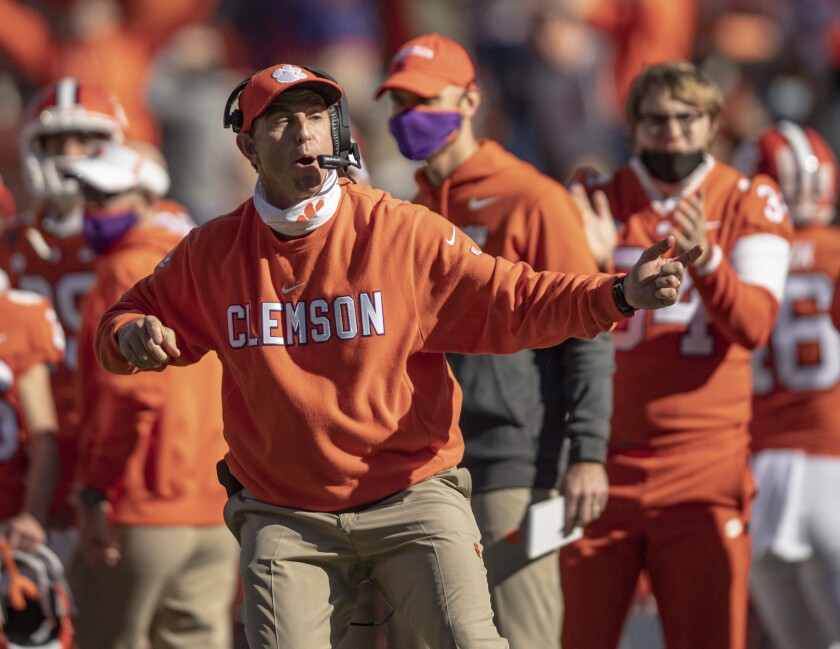 Clemson coach Dabo Swinney talks with players during the second half.