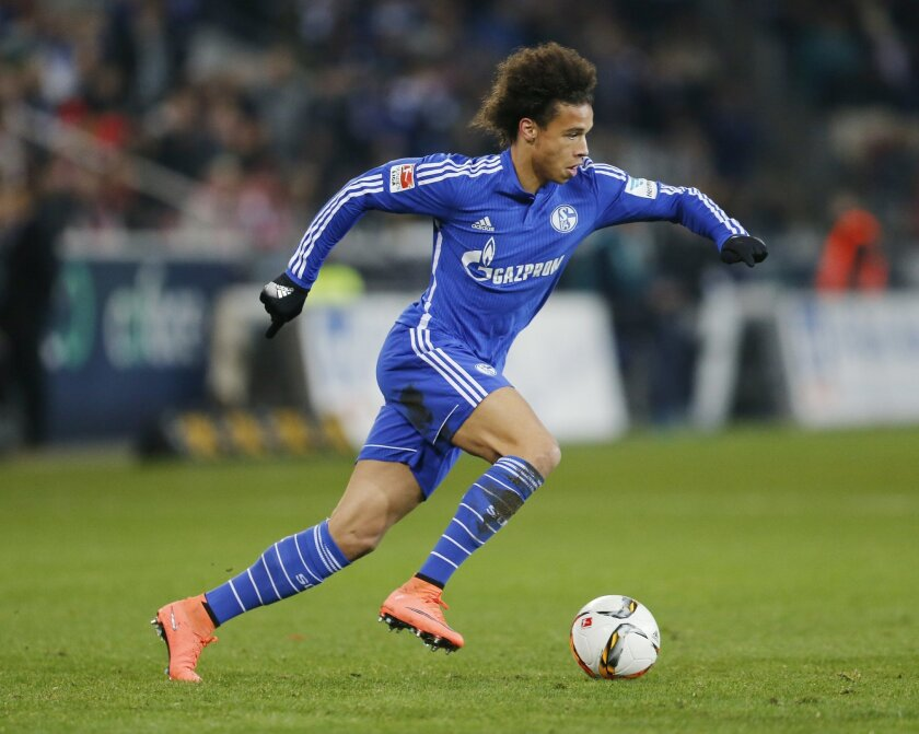 FILE - In this Friday, Feb. 12, 2016 file photo,  Schalke's Leroy Sane runs with the ball during a German Bundesliga soccer match between FSV Mainz 05 and FC Schalke 04 in Mainz, Germany. Many nations are betting on youth at the European Championship, giving promising youngsters a chance to breakth