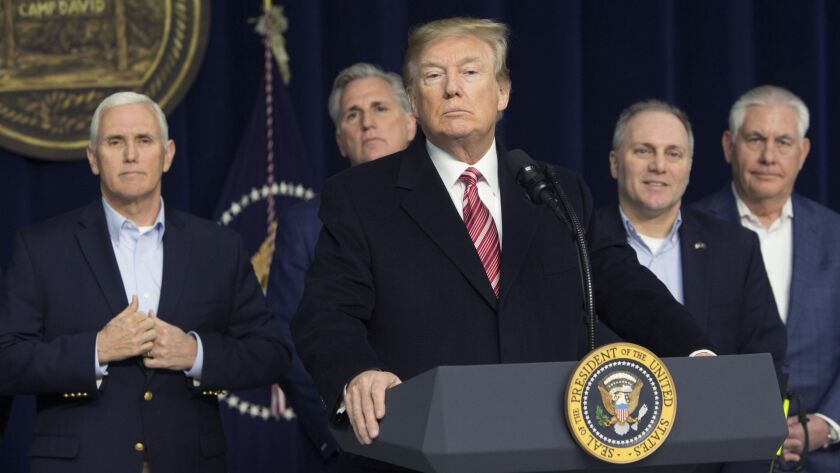 President Trump speaks at Camp David at a Saturday news conference during which he defended his mental capacity. Flanking him, from left, are Vice President Mike Pence, House Majority Leader Kevin McCarthy, House Republican Whip Steve Scalise and Secretary of State Rex Tillerson.